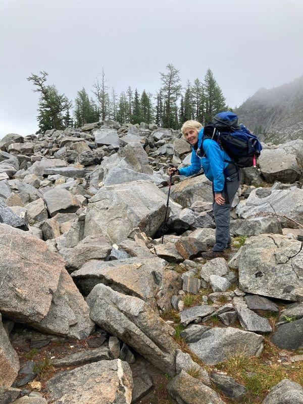 Susan Yates, with backpack, hiking up toward Lake Edna