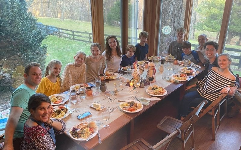 large family gathered around a big long table