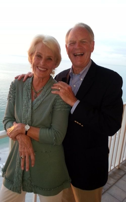 John and Susan Yates standing together overlooking the ocean