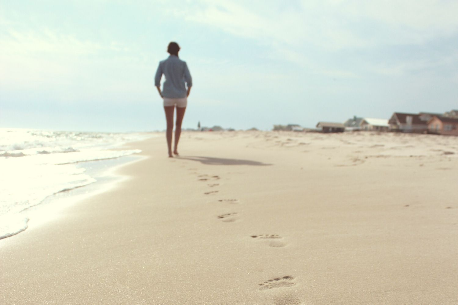 Woman walking alone on beach