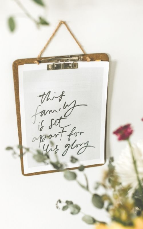 handwritten sign: this family is set apart for his glory